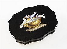 A 19th century Italian micro-mosaic and black slate serpentine shaped paperweight, 5.5in.