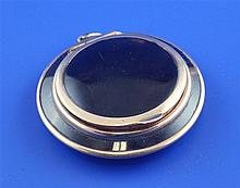 A 9ct gold mounted tortoiseshell compact, 2in.