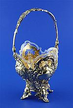 A late 19th century continental pierced repousse silver gilt sugar basket, height 7.5in inc.handle.