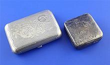 A late 19th century Russian 84 zolotnik silver cigarette case & a snuff box.