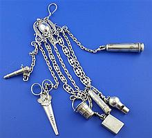 An early 20th century continental silver chatelaine with seven attachments, overall length 10.75in.