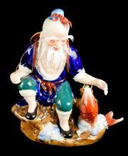 A Porcelain Fisherman Figurine