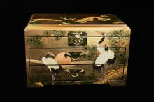 A Hand Painted Black Lacquered with Gold Leaf Jewelry Chest with Pines and Cranes Pattern