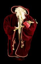 A Limited Edition Red Robe Santa Claus Decorative Doll with a Rabbit Head Cane in Hand