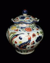A Chinese Penta-Colour (Wucai) Porcelain Jar with Lid with Florals and Fish and Sea Weed, marked as