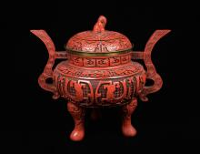 A Chinese Cinnabar Lacquered Tripod Urn with Lid with Brass Interior and Carving