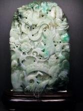 A finely and natural Chinese jadeite covered  a phoenix and peony design, Height 25cm