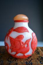 A RED CHROMATOGRAPHY OUTLAID PEKING GLASS SNUFF BOTTLES
