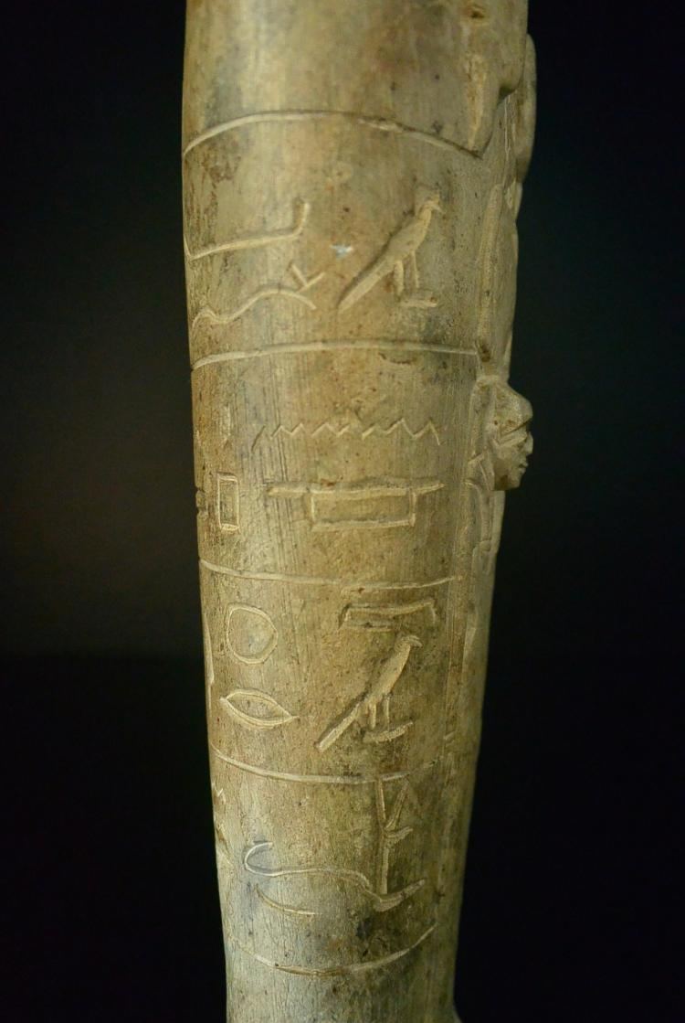 Old stone carving tall figure of a standing egyptian ph