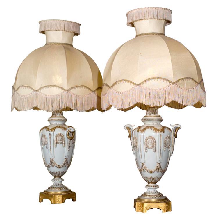 Pair of Ornate White Ceramic Lamps on Bronze Base