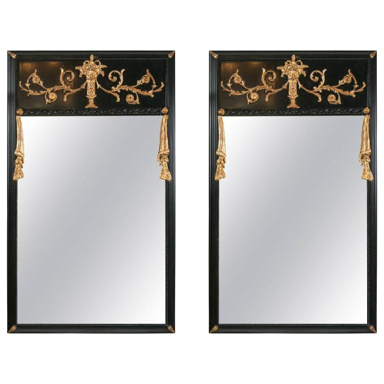 Pair of Ebonized Gilt Drapery Form Carved Trumeau Mirrors