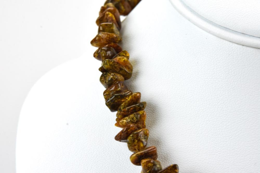 Lot 46: Vintage Amber Bead Necklace Strand