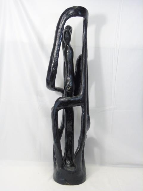 Modern Surrealist Style Cast Statue of a Figure