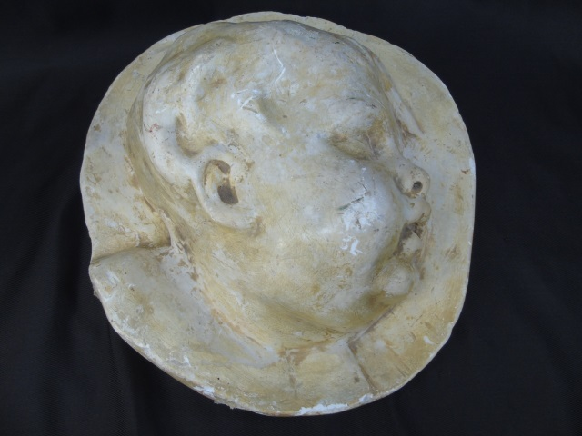 Antique Cast Bas Relief Cupid Head Plaque