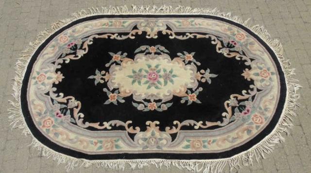 Large Oval Black Background Floral Motif Carpet