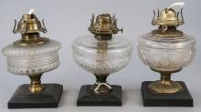 Three Antique Glass & Cast Iron Kerosene Lamps