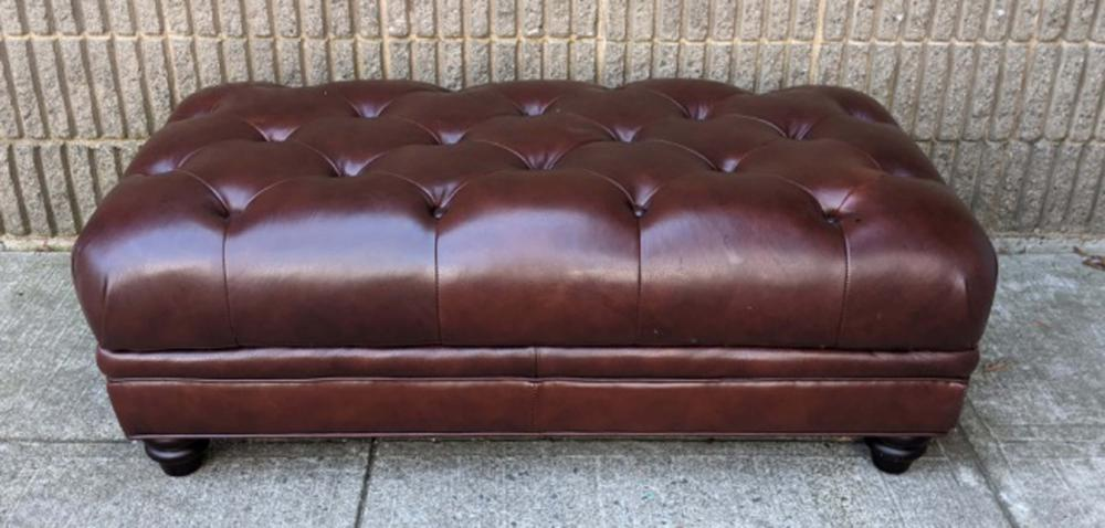 Tufted Brown Leather Upholstered Ottoman Tufted Brown Leather Upholstered Ottoman. Measures 17 inch