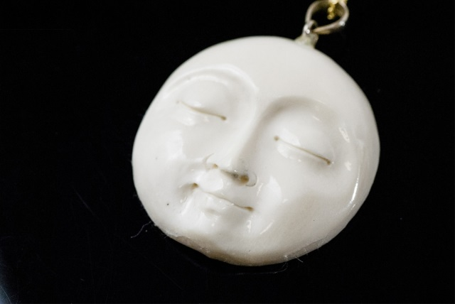 Hand Carved Bone Man In The Moon Necklace Pendant