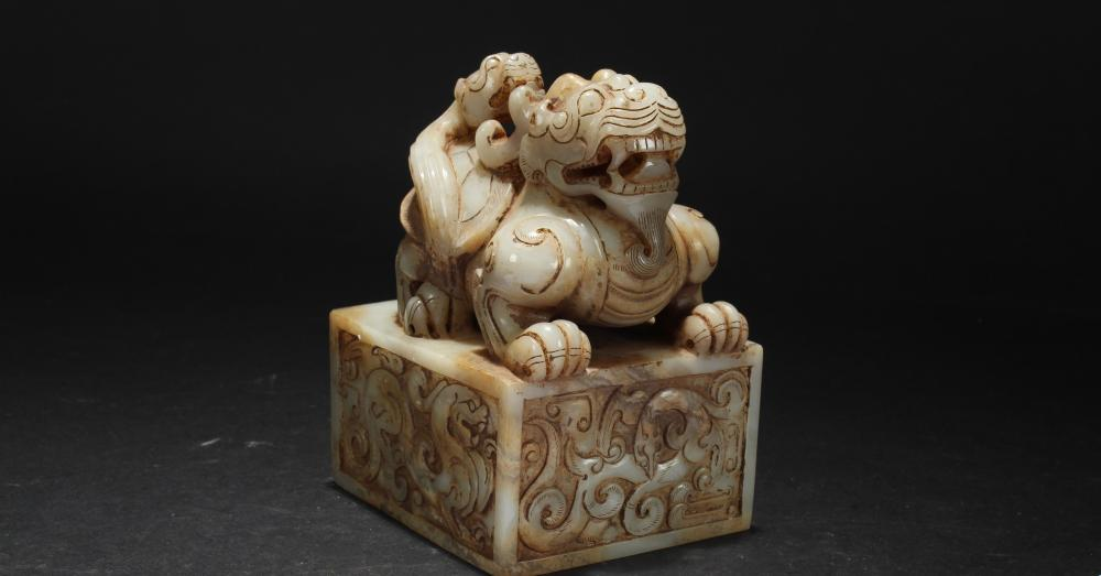 Lot 6: A Chinese Square-based Estate Old-jade Curving Myth-beast Seal