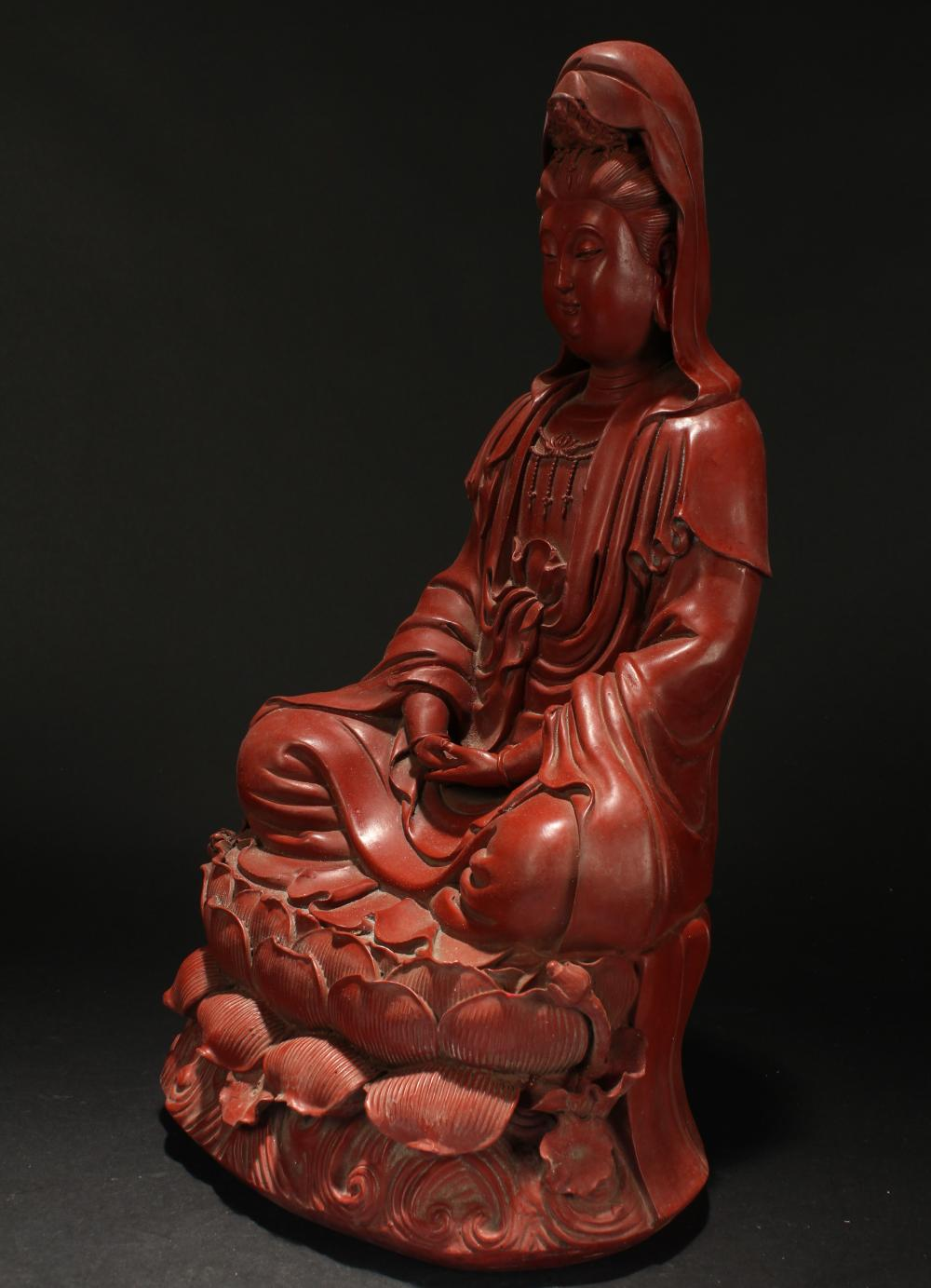 Lot 16: A Chinese Seated Estate Lacquer Guanyin Display Statue