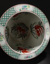 Lot 17: A Chinese Bat-framing Windowed Story-telling Porcelain Circular Vase
