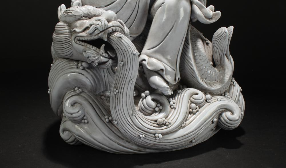 Lot 26: A Chinese Estate White Porcelain Dragon-decorating Statue Display