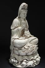 Lot 27: A Chinese Loctus-Seated White Porcelain Guanyin Statue