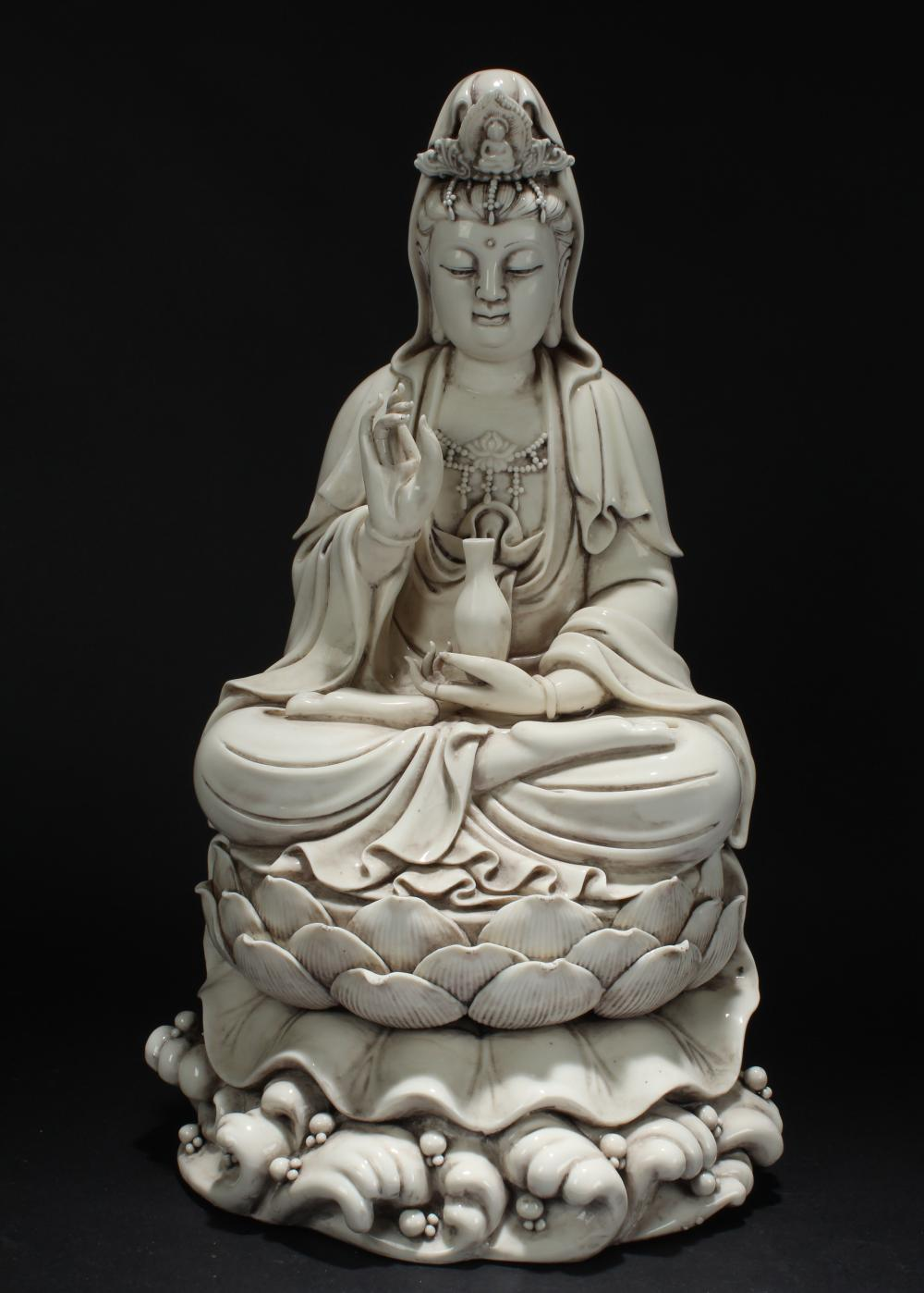 A Chinese Loctus-Seated White Porcelain Guanyin Statue