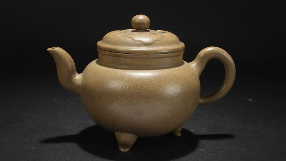 A Chinese Lidded Tri-podded Fortune Tea Pot
