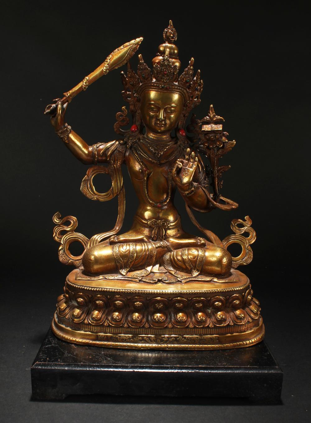 A Tibetan Religious Loctus-seated Estate Buddha Statue