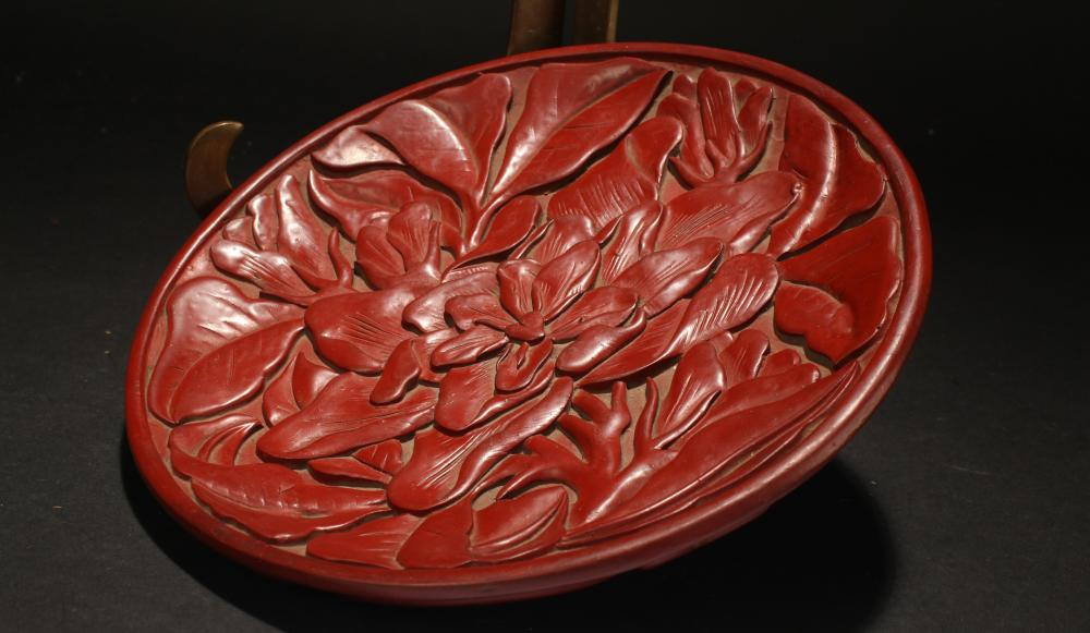 A Chinese Estate Plant-filled Fortune Lacquer Plate
