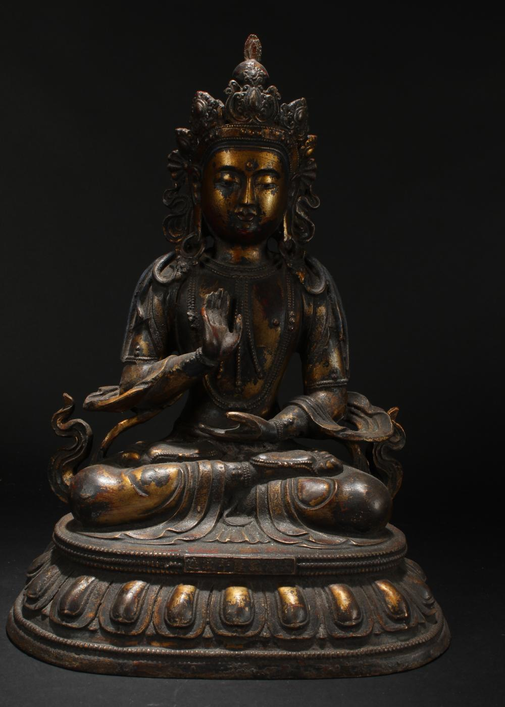 A Chinese Loctus-seated Religious Estate Statue Display