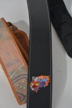 Two of Johnny Winter's Guitar Straps: Dragon and Snakes