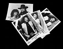Four Promotional Glossies Inscribed by Waylon Jennings