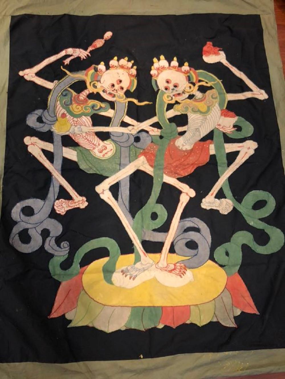 A Tibetan Silk Textile Thangka