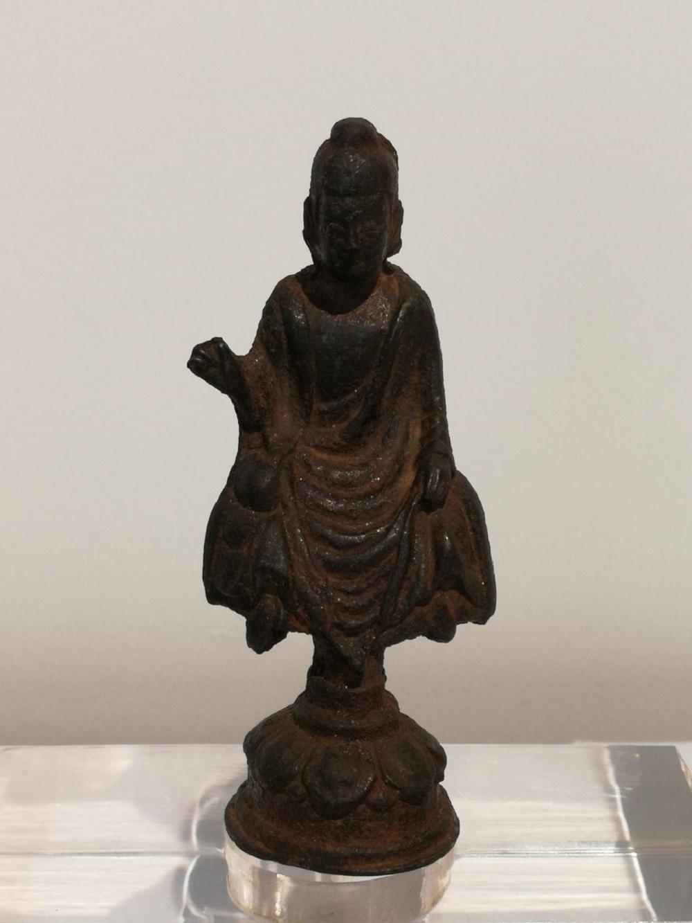 A Tang Dynasty Iron Buddha Statue