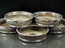 A set of five Old Sheffield plate wine coasters,