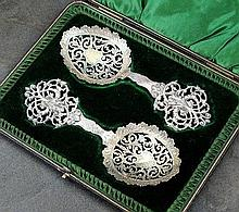 A cased pair of Victorian decorative silver