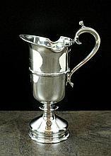 A silver cream jug, Historical Heirlooms, London