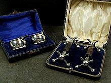 A cased pair of silver napkin rings, T Wilkinson &