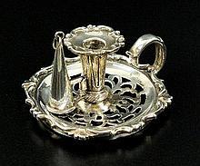 A small Victorian silver taper chamberstick,