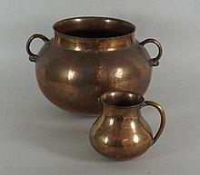 A 17th century bell metal two handled cauldron