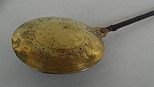 A Charles II brass and iron warming pan, the domed