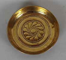 A 16th/17th century brass bowl, probably
