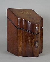 A George III mahogany serpentine cutlery box the