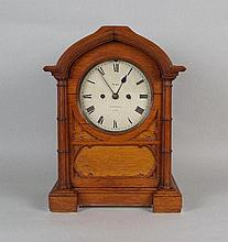 A 19th century oak Gothic style mantel clock the 7