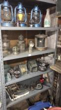 Contents of five shelves including lamps insulators brackets and milk bottle