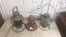3 kerosene lanterns