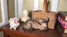 Lot of piggy banks, Mozart bust, cat, basket