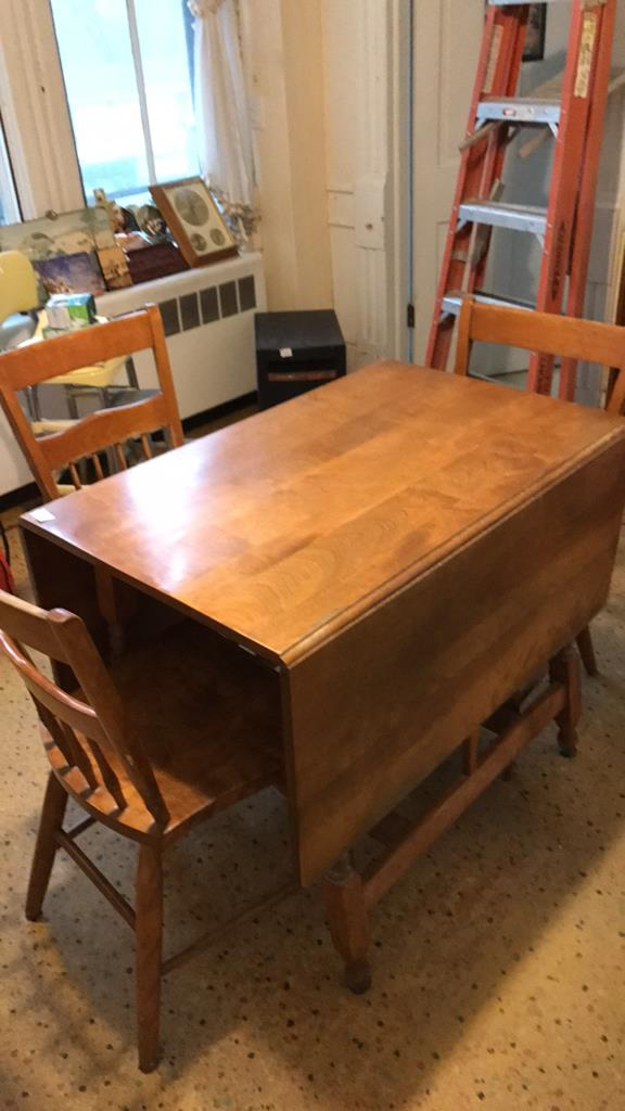 maple kitchen table with three chairs